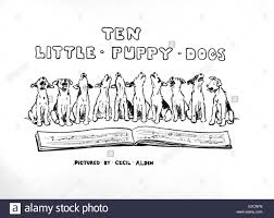 title page design by cecil aldin ten little puppy dogs showing a stock photo title page design by cecil aldin ten little puppy dogs showing a row of ten terrier pups singing or howling from a music manuscript