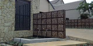gabion rock wall feature water fountain see