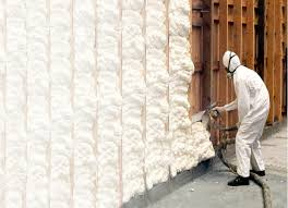 trained applicator applying spray polyurethane foam insulation in wall cavities