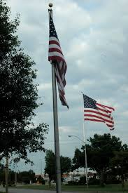 jackhole journo scttrains a great wordpress com site as dark skies move in over lawton wednesday evening a tale of two flags was told on west gore boulevard as the flag latched limply against the pole in