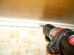 installing under cabinet lighting. Bracket, Tape, Drill Installing Under Cabinet Lighting