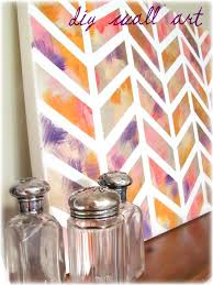 diy wall art chevron is huge right now its also a pattern that can easily be created on a canvas measure mark it off with tape and then paint in your
