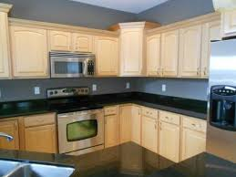 Photo: Pinterest Dark Granite Countertops with Light cabinets and gray wall