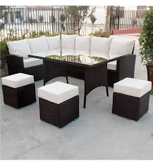 on 9 seater rattan corner garden sofa and dining table brown rattan with light cushions