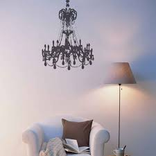 black large grunge chandelier on a white wall