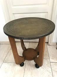 copper top side table with on spherical blackened legs ca arhaus coffee