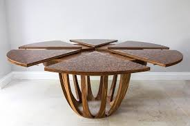 the brown oak expanding circular table is engineered especially for seating a group of 6 or more people each section of this wooden structure is