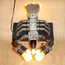 lobster lamp assembled from recycled lamp parts electrical boxes and pipe fittings
