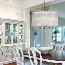 contemporary dining room with decoration lighting drum shade crystal chandelier and wooden baste oval table with