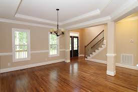 formal dining rooms with columns. from the great room, you can see into two front door foyer with hardwood staircase. chair rail keeps dining space formal. formal rooms columns v
