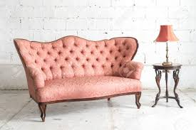 Vintage couch 70s Pink Vintage Sofa And Lamp On White Wall Stock Photo 60981762 Bizbash Pink Vintage Sofa And Lamp On White Wall Stock Photo Picture And