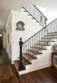 wrought iron railing. Sharp-looking Staircase With Metal Posts And Wrought Iron Railing O