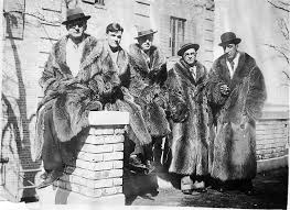 man has worn fur since he was living in a cave but there s something about this photograph and the fresh faced young men all pimped out in full length