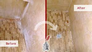 before and after picture of a travertine shower floor stone cleaning service in land o