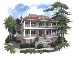 two story raised lowcountry home with two covered wrap around porches