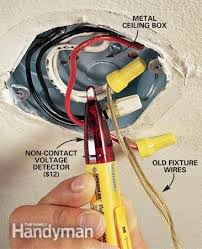 how to hang a ceiling light fixture the family handyman photo 2