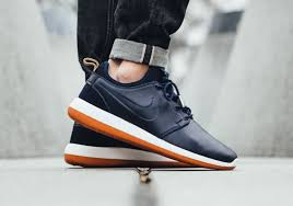recently featured in its off white and black variants the newly introduced nike roshe two leather is now revealed in obsidian as part of its 2007 lineup