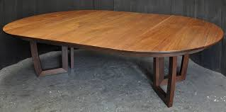 a 60 round walnut table with 3 leaves