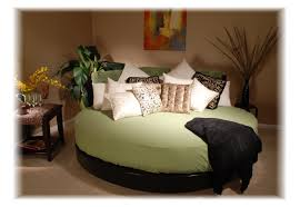 Round Beds Green Round Bed Sheet On Black Wooden Bed Connected By Some Beige