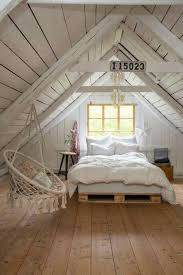 cozy cottage style bedroom in the attic wide plank wood floors white and wood