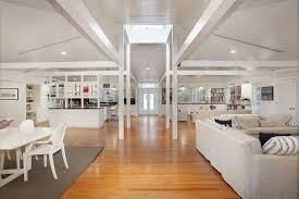contemporary great room with hardwood floors exposed beam crate and barrel delta 30 aluminum crate barrel