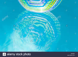 pool water with beach ball. Beach Ball Reflection In Swimming Pool Water With B