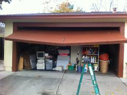 a garage door in pleasanton ca that is broken in the middle