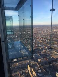 1 353 feet above the streets a couple of glass ledges extend four feet out from the side of the building facebook skydeck chicago