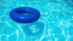 swimming pool. Blue Inner Tube Floating In A Swimming Pool O