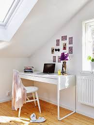 A wonderful, and however, fairly tiny workspace in, you guessed it, an  attic! Normal light always tends to make a space seem bigger, like in this  case.