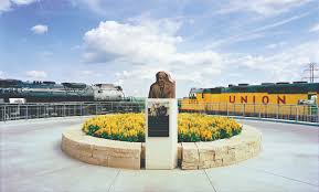 two of the greatest locomotives ever to power union pacific railroad sit atop the southwest corner of lauritzen gardens in kenefick park highly visible to