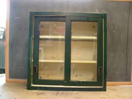 vintage stackable metal cabinet with sliding glass doors view images