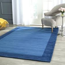 blue wool rug a space dyed felted yarn is woven throughout the cream tufted pile creating a soft textured surface a classic rug for use throughout the home