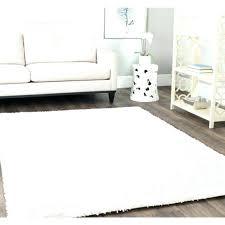 furry carpet fluffy white rug bedroom black bedside table small pillow sky blue dark grey box furry carpet