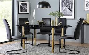 e gold and black gl extending dining table with 4 pica black chairs black