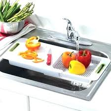 kitchen sinks with cutting board sink cutting board over the chopping kitchen round sink cutting board