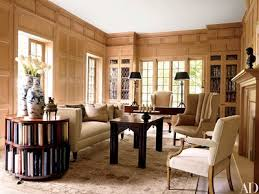 continuing with the neutral theme the library in the same home features a william iv style sofa by lee stanton antiques and a gothic style oak table