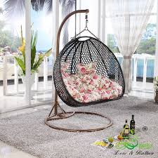 Furniture:Hanging Egg Chair With Black Rattan Combined By White Pink Floral  Patterned Pillow Hanging