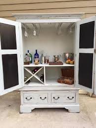 furniture repurpose. updated armoire to make into a bar replaced wood on back so there were no furniture repurpose