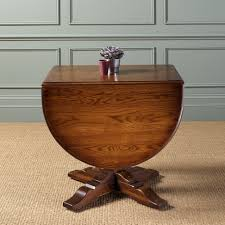 furniture glamorous international concepts round drop leaf pedestal dining table dual in oak oval small