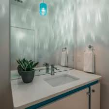 under vanity lighting. Modern White Floating Vanity Under Blue Pendant Light With Decorative, Wavy Cast Lighting