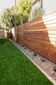 Minimal modern style side yard with wood fencing. Studio H Landscape  Architecture. garden design, landscaping ideas Nice border on the grass.