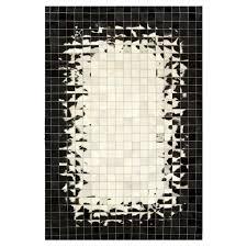 mosaik cowhide rug black white feathered