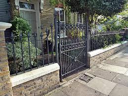 london garden wall with iron rail jpg