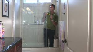 swinging how to clean glass shower door water stains