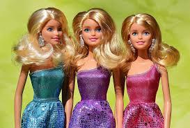 close up photo of three dolls beauty