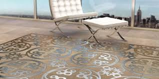 engineered polymer concrete tile with embedded metal decoration by decotal