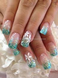 Teal glitter fade in acrylic with white flower freehand nail art ...