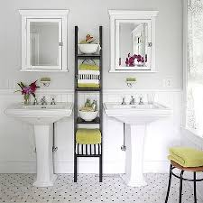 in a small bathroom storage contains clutter and keeps the bathroom clean whereas in a larger bathroom shelving can be used as
