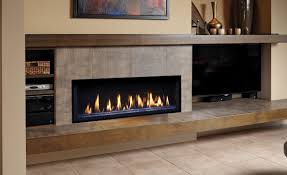 linear fireplace with long hearth and mantle tv on the side